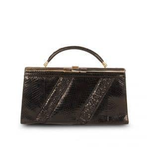 Black snakeskin handbag with concealable handle