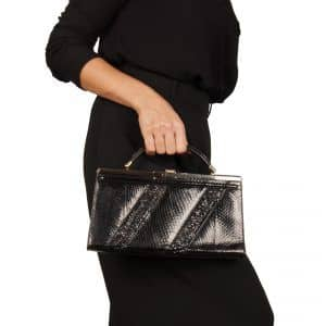 Black snakeskin handbag with concealable handle model